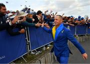 30 September 2018; Alex Norén of Europe celebrates with supporters after winning the Ryder Cup following the Ryder Cup 2018 Matches at Le Golf National in Paris, France. Photo by Ramsey Cardy/Sportsfile