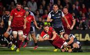 14 September 2018; Andrew Conway of Munster is tackled by Luke Morgan of Ospreys during the Guinness PRO14 Round 3 match between Munster and Ospreys at Irish Independent Park in Cork. Photo by Brendan Moran/Sportsfile