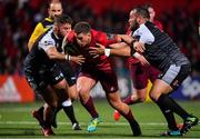 14 September 2018; Ian Keatley of Munster is tackled by Morgan Morris and Alex Jeffries of Ospreys during the Guinness PRO14 Round 3 match between Munster and Ospreys at Irish Independent Park in Cork. Photo by Brendan Moran/Sportsfile