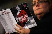 5 October 2018; Dundalk supporter Siobhan Kelly studies the match programme prior to the SSE Airtricity League Premier Division match between Dundalk and St Patrick's Athletic at Oriel Park, Dundalk, in Louth. Photo by David Fitzgerald/Sportsfile