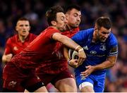 6 October 2018; Fergus McFadden of Leinster is tackled by Darren Sweetnam, left, and Niall Scannell of Munster during the Guinness PRO14 Round 6 match between Leinster and Munster at the Aviva Stadium in Dublin. Photo by Seb Daly/Sportsfile