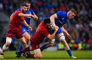 6 October 2018; Dan Leavy of Leinster is tackled by Niall Scannell of Munster during the Guinness PRO14 Round 6 match between Leinster and Munster at the Aviva Stadium in Dublin. Photo by Ramsey Cardy/Sportsfile