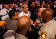 6 October 2018; Dillon Danis is surrounded following an attack after Conor McGregor was defeated by Khabib Nurmagomedov in their UFC lightweight championship fight during UFC 229 at T-Mobile Arena in Las Vegas, Nevada, USA. Photo by Stephen McCarthy/Sportsfile