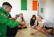13 October 2018; Team Ireland athletes, from left, Dean Clancy, from Ballinacarrow, Sligo, Niamh Coyne, from Tallaght, Dublin, Emma Slevin, from Renmore, Galway and Mona McSharry, from Grange, Sligo, playing a game of cards, in the Youth Olympic Village, on Day 7 of the Youth Olympic Games in Buenos Aires, Argentina. Photo by Eóin Noonan/Sportsfile