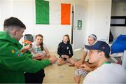 13 October 2018; Team Ireland athletes, from left, Dean Clancy, from Ballinacarrow, Sligo, Niamh Coyne, from Tallaght, Dublin, Emma Slevin, from Renmore, Galway, Mona McSharry, from Grange, Sligo, and Robert Powell, from Athlone, Westmeath, playing a game of cards, in the Youth Olympic Village, on Day 7 of the Youth Olympic Games in Buenos Aires, Argentina. Photo by Eóin Noonan/Sportsfile