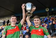 14 October 2018; St.Brigid's captains Ciaran Sugrue, left, and Paul McGrath lift the cup after the Roscommon County Minor Club Football Championship Final match between Castlerea St. Kevin's and St Brigid's at Dr Hyde Park, Roscommon. Photo by Barry Cregg/Sportsfile