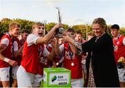 14 October 2018; Kyle Conway of St. Patricks's Athletic is presented with the cup by Leanne Sheil of SSE Artricitythe National Under 15 Cup Final match between St. Patrick's Athletic and Cork City at Richmond Park in Inchicore, Dublin. Photo by Tom Beary/Sportsfile
