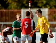 14 October 2018; Joshua Keeley of St. Patrick's Athletic after being shown a red card by Referee Joe McDonnell during the National Under 15 Cup Final match between St. Patrick's Athletic and Cork City at Richmond Park in Inchicore, Dublin. Photo by Tom Beary/Sportsfile