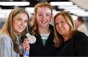 15 October 2018; Niamh Coyne of Team Ireland, from Tallaght, Dublin, with her sister Aoife and mother Paula, and her silver medal from the women's 100m breaststroke, on the Team Ireland swimming team return from the Youth Olympic Games in Buenos Aires at Dublin Airport in Dublin. Photo by Brendan Moran/Sportsfile