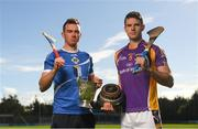 15 October 2018; Ballyboden St. Enda's hurler Simon Lambert, left, and Kilmacud Crokes hurler Rob Murphy with The New Ireland Assurance Company Perpetual Challenge Cup during a Dublin SHC / SFC Finals Media Launch at Parnell Park in Dublin. Photo by Piaras Ó Mídheach/Sportsfile