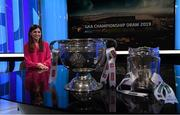 11 October 2018; RTÉ presenter Joanne Cantwell with The Sam Maguire Cup and The Liam Mac Carthy Cup during The GAA Championship Draw 2019 at RTÉ Studios in Donnybrook, Dublin.   Photo by Piaras Ó Mídheach/Sportsfile