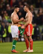 16 October 2018; Shane Long of Republic of Ireland, left, and James Chester of Wales shake hands following the UEFA Nations League B group four match between Republic of Ireland and Wales at the Aviva Stadium in Dublin. Photo by Seb Daly/Sportsfile