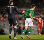 16 October 2018; Shane Long of Republic of Ireland is held back by Wayne Hennessey of Wales during the UEFA Nations League B group four match between Republic of Ireland and Wales at the Aviva Stadium in Dublin. Photo by Seb Daly/Sportsfile
