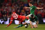 16 October 2018; Harry Arter and Shane Duffy of Republic of Ireland tackle Tyler Roberts of Wales during the UEFA Nations League B group four match between Republic of Ireland and Wales at the Aviva Stadium in Dublin. Photo by Brendan Moran/Sportsfile
