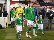 16 October 2018; Lee O'Connor of Republic of Ireland walks out with mascots Donnacha Nolan and Kik Pierie of Netherlands with mascot Dylan Walsh during the 2018/19 UEFA Under-19 European Championships Qualifying Round match between Republic of Ireland and Netherlands at City Calling Stadium, in Lissanurlan, Co. Longford. Photo by Harry Murphy/Sportsfile