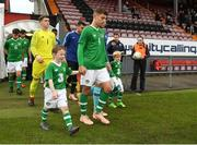 16 October 2018; Lee O'Connor of Republic of Ireland walks out with mascots Donnacha Nolan and Dylan Walsh during the 2018/19 UEFA Under-19 European Championships Qualifying Round between Republic of Ireland and Netherlands at City Calling Stadium, in Lissanurlan, Co. Longford. Photo by Harry Murphy/Sportsfile