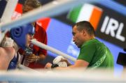 17 October 2018; Dearbhla Rooney of Team Ireland, from Manorhamilton, Leitrim, taking advice from her coach Dimitri Dmitruk between rounds during the women's featherweight bronze medal bout on Day 11 of the Youth Olympic Games in Buenos Aires, Argentina. Photo by Eóin Noonan/Sportsfile