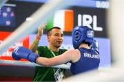 17 October 2018; Dearbhla Rooney of Team Ireland, from Manorhamilton, Leitrim, celebrates with her coach Dimitri Dmitruk after beating Te Mania Rzeka Tai Shelford-Edmonds of New Zealand during the women's featherweight bronze medal bout on Day 11 of the Youth Olympic Games in Buenos Aires, Argentina. Photo by Eóin Noonan/Sportsfile