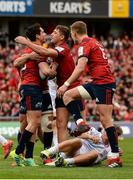20 October 2018; Joey Carbery, left, of Munster celebrates with team-mates Dan Goggin, centre, and Mike Haley after scoring his side's third try during the Heineken Champions Cup Pool 2 Round 2 match between Munster and Gloucester at Thomond Park in Limerick. Photo by Diarmuid Greene/Sportsfile