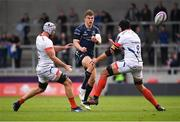 20 October 2018; Tom Farrell of Connacht kicks under pressure from Bryn Evans, left, and Josh Beaumont of Sale Sharks during the Heineken Challenge Cup Pool 3 Round 2 match between Sale Sharks and Connacht at AJ Bell Stadium, in Salford, England. Photo by Harry Murphy/Sportsfile