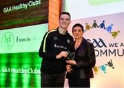 20 October 2018; Dublin and Raheny footballer Brian Fenton presents the 'Hero Award' to Caroline Clifford of Clara during the GAA National Healthy Club Conference at Croke Park Stadium, in Dublin. Photo by David Fitzgerald/Sportsfile