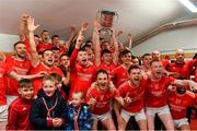 20 October 2018; Ballintubber players, management, and supporters celebrate with the Paddy Moclair Cup in the dressing room after the Mayo County Senior Club Football Championship Final match between Breaffy and Ballintubber at Elverys MacHale Park, in Castlebar, Mayo. Photo by Piaras Ó Mídheach/Sportsfile