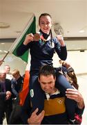 21 October 2018; Dearbhla Rooney of Team Ireland, centre, from Manorhamilton, Leitrim, with her bronze medal from the women's featherweight boxing with her father, Padraig, during her return from the Youth Olympic Games in Buenos Aires at Dublin Airport in Dublin. Photo by Eóin Noonan/Sportsfile