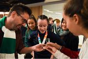 21 October 2018; Dearbhla Rooney of Team Ireland, centre, from Manorhamilton, Leitrim, shows her bronze medal from the women's featherweight boxing to family and friends on her return from the Youth Olympic Games in Buenos Aires at Dublin Airport in Dublin. Photo by Eóin Noonan/Sportsfile