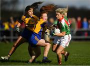 21 October 2018; Cora Staunton of Carnacon in action against Roisin Flynn, left, and Nina McVann of Knockmore during the Mayo County Senior Club Ladies Football Final match between Carnacon and Knockmore at Kilmeena GAA Club in Mayo. Photo by David Fitzgerald/Sportsfile
