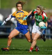 21 October 2018; Cora Staunton of Carnacon in action against Emma Lowther of Knockmore during the Mayo County Senior Club Ladies Football Final match between Carnacon and Knockmore at Kilmeena GAA Club in Mayo. Photo by David Fitzgerald/Sportsfile