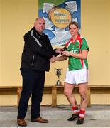 21 October 2018; Mayo Ladies' County Board secretary Kevin McDonnell presents the player of the match award to Cora Staunton of Carnacon following the Mayo County Senior Club Ladies Football Final match between Carnacon and Knockmore at Kilmeena GAA Club in Mayo. Photo by David Fitzgerald/Sportsfile