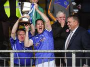 21 October 2018; Coalisland captain Stephen McNally and Shane Corr lift the cup after winning the Tyrone County Senior Club Football Championship Final match between Coalisland Fianna and Killyclogher St Mary's at Healy Park, Omagh, in Tyrone. Photo by Philip Fitzpatrick/Sportsfile