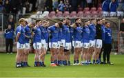 21 October 2018; Coalisland players observe a minute's silence prior to the Tyrone County Senior Club Football Championship Final match between Coalisland Fianna and Killyclogher St Mary's at Healy Park, Omagh, in Tyrone. Photo by Philip Fitzpatrick/Sportsfile