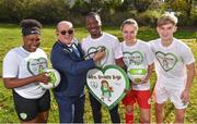 22 October 2018; The Football Association of Ireland have teamed up with Brendan & Jenny O'Carroll from Mrs. Brown's Boys, to provide cardiac screening to all childrenand adolescents from the National League squads. At grassroots level, the initiative will train all coaches around the country in the use of defibrillators, CPR and basic life support. This training is accredited by the Irish Heart Foundation. The FAI began cardiac screening of the Republic of Ireland Under-15 players in 2007 and then extended that to cover domesticleague players the following year. This initiative will involve the screening of players in the U-13, U-15, U-17 & U-19 tiers, as well as the U-17s in the Women's National League. Pictured at the launch is creator of Mrs. Brown's Boys Brendan O'Carroll, with players, from left, Aiso Aikhionbare of Greystones U17, Peter Adigun of Bohemians U19, Oleta Griffin of Shelbourne U17 and William Chelaru of St Patrick's Athletic U15, at the FAI National Training Centre in Abbotstown, Dublin.  Photo by Seb Daly/Sportsfile