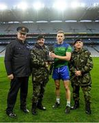 22 October 2018; The winning captain Denis Maher of The Irish Defence Forces is presented with the cup by, from left, Assistant Commissioner of An Garda Síochána Fintan Fanning alongside Chief of Staff Mark Mellet and Major General Kieran Brennan, of The Irish Defence Forces, after the President's Cup match between The Irish Defence Forces and An Garda Síochána at Croke Park in Dublin. Photo by Piaras Ó Mídheach/Sportsfile