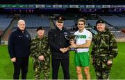 22 October 2018; Winning captain Gary White of The Irish Defence Forces is presented with the cup by, from left, Detective Sergeant Brian Willoughby, Major General Kieran Brennan, Assistant Commissioner of An Garda Síochána Fintan Fanning, and Chief of Staff Mark Mellet after the John Morley Memorial Cup match between The Irish Defence Forces and An Garda Síochána at Croke Park in Dublin.  Photo by Piaras Ó Mídheach/Sportsfile