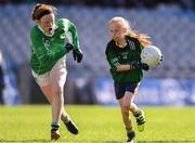 22 October 2018; Hannah Ní Mhórdha of Gaelscoil Bhaile Brigín in action against Katie Teefy of Ballyboughal NS during day 1 of the Allianz Cumann na mBunscol Finals at Croke Park in Dublin.  Photo by Sam Barnes/Sportsfile