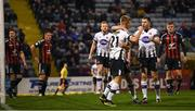 26 October 2018; Daniel Cleary, 21, is congratulated by his Dundalk team-mates Ronan Murray and Brian Gartland, right, after scoring his side's first goal during the SSE Airtricity League Premier Division match between Bohemians and Dundalk at Dalymount Park in Dublin. Photo by Stephen McCarthy/Sportsfile