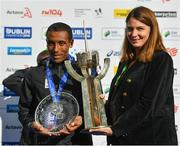 28 October 2018; Asefa Bekele of Ethiopia accepts the Noel Carroll Trophy for top male finisher, presented by Enda Carroll of the Carroll family today at the 2018 SSE Airtricity Dublin Marathon. 20,000 runners took to the Fitzwilliam Square start line to participate in the 39th running of the SSE Airtricity Dublin Marathon, making it the fifth largest marathon in Europe. Photo by Ramsey Cardy/Sportsfile