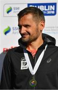 28 October 2018; On the podium following the 2018 SSE Airtricity Dublin Marathon is second placed finisher in the Athletics Ireland National Championships Sergiu Ciobanu of Clonliffe Harriers A.C., Dublin,20,000 runners took to the Fitzwilliam Square start line to participate in the 39th running of the SSE Airtricity Dublin Marathon, making it the fifth largest marathon in Europe. Photo by Ramsey Cardy/Sportsfile