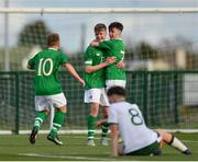 29 October 2018; Evan Ferguson of Republic of Ireland U15, centre, is congratulated by team-mates Ben Quinn, right, and John Joe Power, left, after scoring his side's first goal during the Republic of Ireland U15 and Republic of Ireland U16 match at FAI National Training Centre in Abbotstown, Dublin. Photo by Seb Daly/Sportsfile