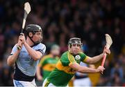 4 November 2018; Peter Casey of Na Piarsaigh scores his side's second goal under pressure from Joey O'Keeffe of Clonoulty / Rossmore during the AIB Munster GAA Hurling Senior Club Championship semi-final match between Na Piarsaigh and Clonoulty / Rossmore at the Gaelic Grounds in Limerick. Photo by Piaras Ó Mídheach/Sportsfile