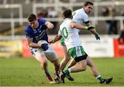 4 November 2018; Darren Hughes of Scotstown in action against Cathal Foy, left, and Declan Rooney of Burren during the AIB Ulster GAA Football Senior Club Championship quarter-final match between Burren and Scotstown at Páirc Esler in Newry, Down. Photo by Oliver McVeigh/Sportsfile