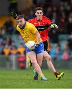 4 November 2018; Dylan Guiry of The Nire in action against Paul Maher of Adare during the AIB Munster GAA Football Senior Club Championship quarter-final match between Adare and The Nire at the Gaelic Grounds in Limerick. Photo by Piaras Ó Mídheach/Sportsfile