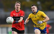 4 November 2018; Mikey Lyons of Adare in action against Jamie Barron of The Nire during the AIB Munster GAA Football Senior Club Championship quarter-final match between Adare and The Nire at the Gaelic Grounds in Limerick. Photo by Piaras Ó Mídheach/Sportsfile