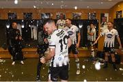 4 November 2018; Ronan Murray of Dundalk celebrates with the cup in the dressing room after the Irish Daily Mail FAI Cup Final match between Cork City and Dundalk at the Aviva Stadium in Dublin. Photo by Eóin Noonan/Sportsfile