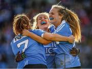 "Three's company – but the attendance of 50,141 is a record. This is the first time the 50,000 mark has been passed in an All-Ireland ladies football final, a fitting stage for the ecstatic Dublin trio of Niamh Collins, Sinéad Finnegan and Amy Connolly.  This image may be reproduced free of charge when used in conjunction with a review of the book ""A Season of Sundays 2018"". All other usage © SPORTSFILE"