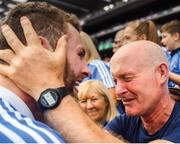 "Like father like son. There is raw emotion in the meeting of former Dublin defender Noel McCaffrey and his son Jack after the game. Amazingly, this is the first time Jack has been on the field at the end of an All-Ireland final. Last year he had to depart after just four minutes with a cruciate ligament tear; in 2016 he watched both games against Mayo from the stand having taken the year off to work in Africa; and he was substituted in the 2013 final and again in 2015 when he was feeling ill.    This image may be reproduced free of charge when used in conjunction with a review of the book ""A Season of Sundays 2018"". All other usage © SPORTSFILE"