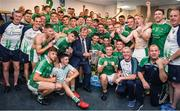 "A winning dressingroom is a happy dressingroom. The Limerick players and backroom, including manager John Kiely, celebrate victory in the company of their long-time supporter and sponsor JP McManus.    This image may be reproduced free of charge when used in conjunction with a review of the book ""A Season of Sundays 2018"". All other usage © SPORTSFILE"