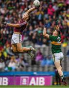 "Acrobatic, athletic, awesome. Galway captain Damien Comer spectacularly claims the ball one-handed in the air with Jason Foley of Kerry barely getting off the ground. In many ways the incident sums up a game that raises serious doubts about Kerry's All-Ireland credentials. But victory comes at a cost for Galway with Paul Conroy sustaining a broken leg.    This image may be reproduced free of charge when used in conjunction with a review of the book ""A Season of Sundays 2018"". All other usage © SPORTSFILE"
